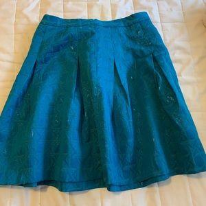 Kirna Zabete teal skirt.